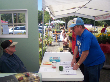 Master Gardener John Morgan answers questions at Timeless Garden Tomato & Salso Fest