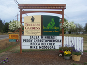 Timeless Gardens sign with salsa winners